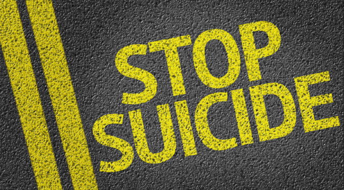 Stop Suicide written on the road